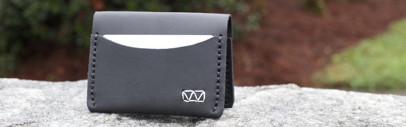 Madison 3-Pocket Wallet on a Rock Outside.
